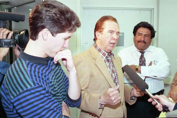 The Rev. John Osteen, flanked by his son Joel, left, and Jesse Gallardo, chief of church security, says it was a miracle that his daughter survived a pipe-bomb blast. Lisa Osteen, 31, was opening a package addressed to her father when it exploded Jan. 30, 1990. The three are at Ben Taub Hospital.