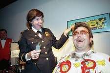 HPD Chief-designate Elizabeth Watson shaves KLOL radio personality James Smith Carney's beard on Jan. 25, 1990. Carney is known on the air as Moby. Watson shaved his full beard in a window of Neiman Marcus at the Galleria to raise $8,200 for United Cerebral Palsy. It was Carney's first shave in 14 years.
