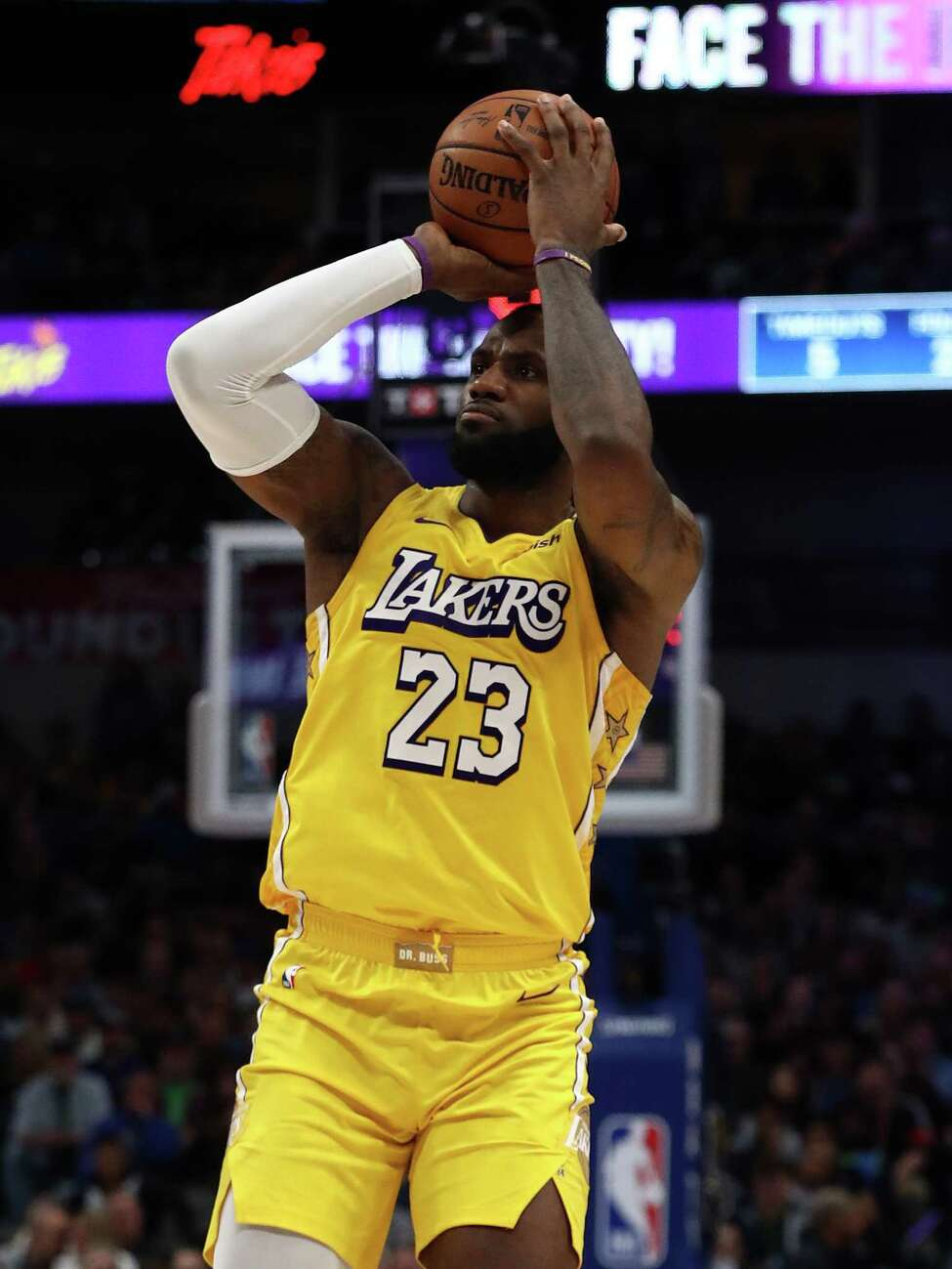 DALLAS, TEXAS - JANUARY 10: LeBron James #23 of the Los Angeles Lakers takes a shot against the Dallas Mavericks at American Airlines Center on January 10, 2020 in Dallas, Texas. NOTE TO USER: User expressly acknowledges and agrees that, by downloading and or using this photograph, User is consenting to the terms and conditions of the Getty Images License Agreement. (Photo by Ronald Martinez/Getty Images)