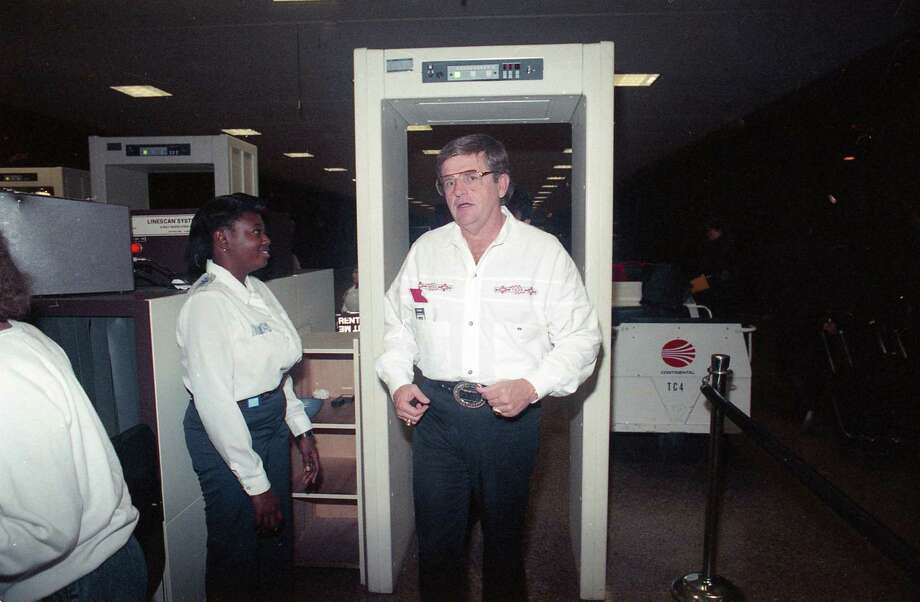 Oilers Coach Jerry Glanville, his tenure a hot topic since the team's poor finish, heads for a flight Wednesday, Jan. 3, 1990, at Houston Intercontinental Airport after meeting with Oilers brass. His destination: a job interview with the Atlanta Falcons. Photo: John Davenport, Houston Chronicle