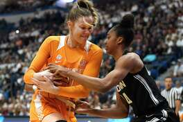 Tennessee's Lou Brown, left, and Connecticut's Aubrey Griffin fight for possession of the ball in the first half of an NCAA college basketball game, Thursday, Jan. 23, 2020, in Hartford, Conn.