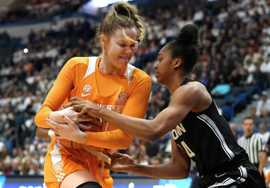 Tennessee's Lou Brown, left, and UConn'sAubrey Griffin fight for possession of the ball in the first half on Thursday in Hartford. For complete game coverage visit greenwichtime.com/sports. Photo: Jessica Hill / Associated Press / Copyright 2020 The Associated Press. All rights reserved.