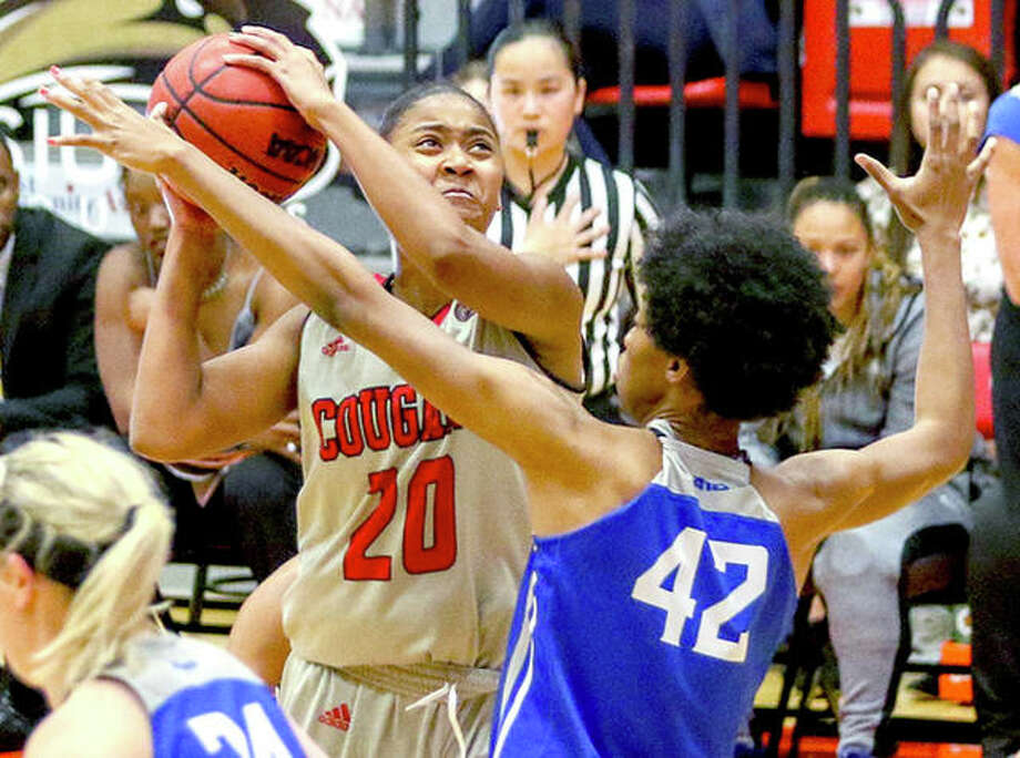 SIUE's Kaitlin Lee (20), making her first career start, scored 18 points in the Cougars' 66-56 loss to Southeast Missouri State University Thursday night at SIUE. She is shown in action against Saint Louis University.