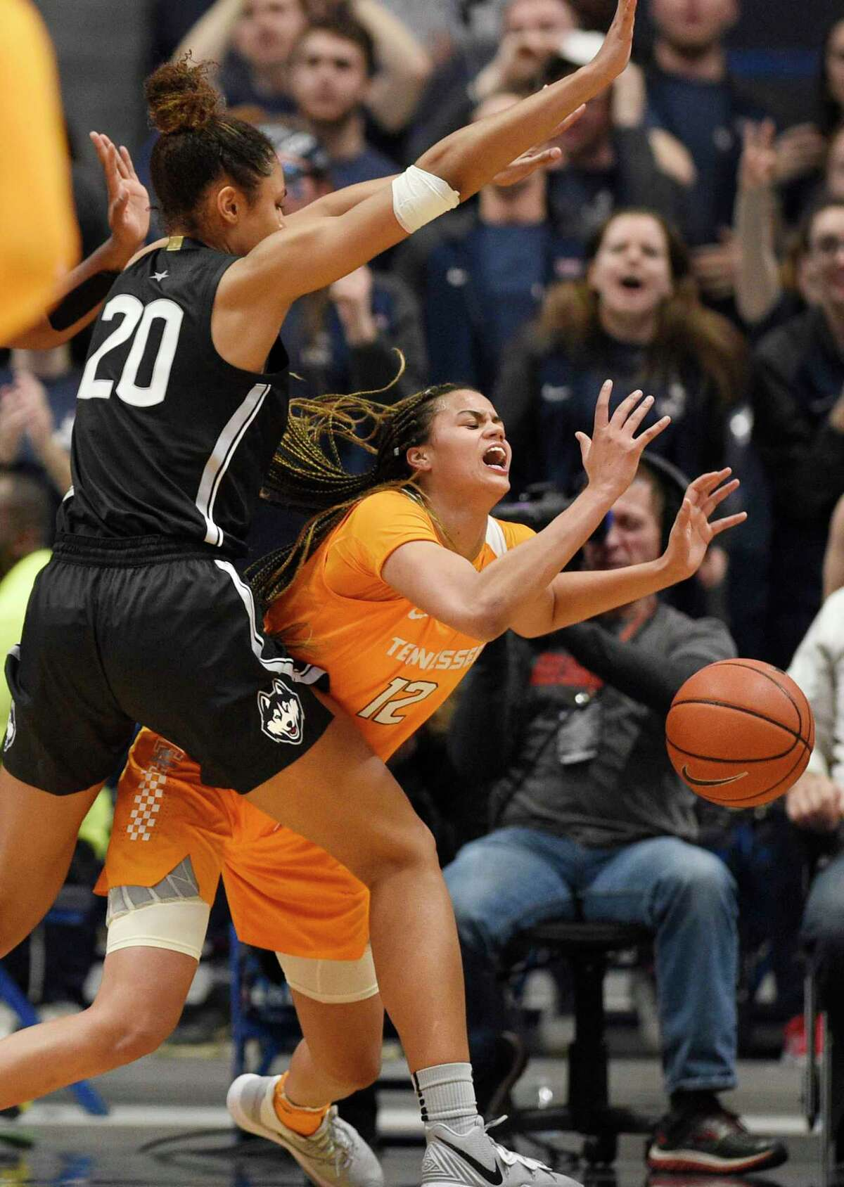 Tennessee's Rae Burrell (12) loses the ball under pressure from Connecticut's Olivia Nelson-Ododa (20) in the second half of an NCAA college basketball game, Thursday, Jan. 23, 2020, in Hartford, Conn.