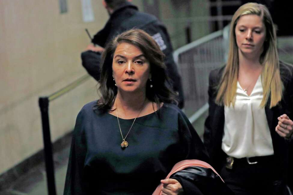 Actress Annabella Sciorra, left, leaves Manhattan Criminal Court after appearing at Harvey Weinstein's rape and sexual assault trial, Thursday, Jan. 23, 2020, in New York. (AP Photo/Kathy Willens)