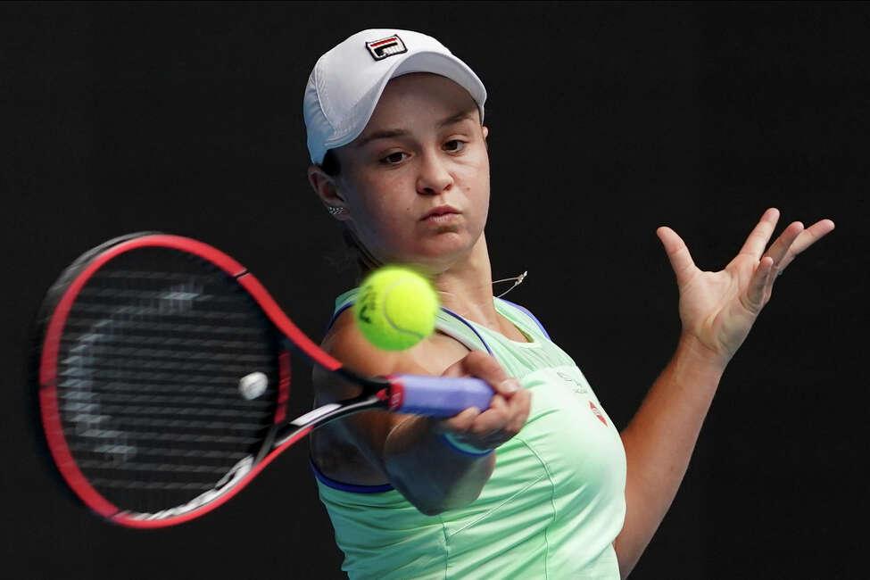 Australia's Ashleigh Barty makes a forehand return to Kazakhstan's Elena Rybakina in their third round match at the Australian Open tennis championship in Melbourne, Australia, Friday, Jan. 24, 2020. (AP Photo/Lee Jin-man)