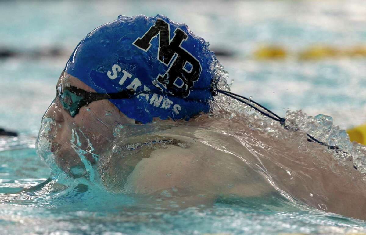 New Braunfels' Garrett Starnes competes Thursday afternoon, Jan. 23, 2020 in the 100 yard butterfly during the District 26-6A swimming meet NEISD's Bill Waller Pool.