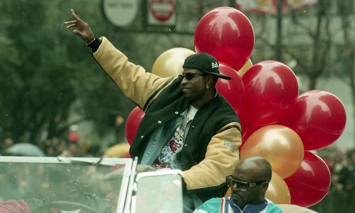 San Francisco 49ers Cornerback Deion Sanders waves to 49ers fans during the Super Bowl XXIX parade in San Francisco, Calif. on January 30, 1995.