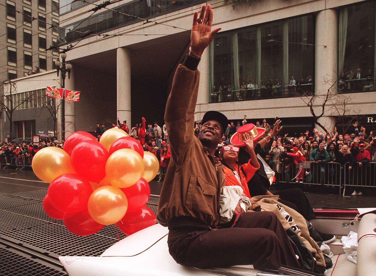 San Francisco 49ers Wide Receiver Jerry Rice waves to 49ers fans during the Super Bowl XXIX parade in San Francisco, Calif. on January 30, 1995.