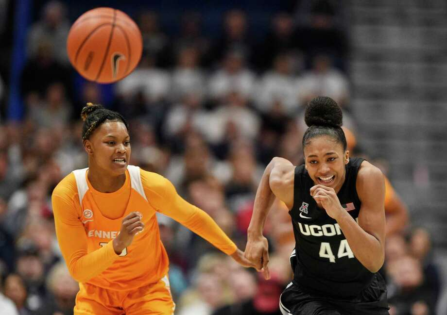 Tennessee's Jazmine Massengill, left, and Connecticut's Aubrey Griffin chase a loose ball in the first half of an NCAA college basketball game, Thursday, Jan. 23, 2020, in Hartford, Conn. (AP Photo/Jessica Hill) Photo: Jessica Hill / Associated Press / Copyright 2020 The Associated Press. All rights reserved.