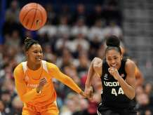 Tennessee's Jazmine Massengill, left, and Connecticut's Aubrey Griffin chase a loose ball in the first half of an NCAA college basketball game, Thursday, Jan. 23, 2020, in Hartford, Conn. (AP Photo/Jessica Hill)