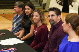 United South cross country runner Julissa Garza is joined by Joe Coronado, Christina Tristan and her parents Johnny Garza and Laura Garza as she signs her National Letter of Intent on Thursday committing to continue her career with TAMIU.