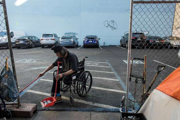 Michael Hwang, 67, sweeps the parking lot at Jones and Turk Streets on Wednesday, Jan. 22, 2020 in San Francisco, Calif. The city of San Francisco rejected a proposal to build tiny units for the homeless on a parking lot at 180 Jones Street.