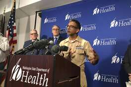 Satish Pillai, right, a medical officer for the CDC, speaks Tuesday Jan. 21, 2020, at a news conference in Shoreline, Wash., following the announcement that a man in Washington state is the first known person in the United States to catch a new type of coronavirus that officials believe originated in China. Looking on are Washington Gov. Jay Inslee, second from left, and John Wiesman,, left, Washington state Secretary of Health. The man who caught the virus is a Washington state resident who returned last week from China and is currently hospitalized near Seattle. (AP Photo/Carla K. Johnson)