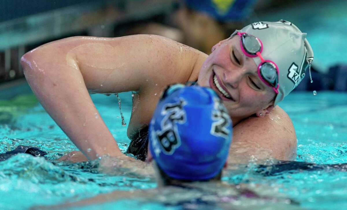 Steele's Evelyn Bruner celebrates Thursday afternoon, Jan. 23, 2020 after setting a district record in the 200 yard freestyle during the District 26-6A swimming meet at NEISD's Bill Waller Pool.