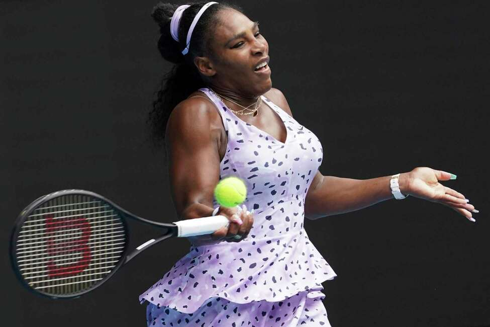 Serena Williams of the U.S. returns a forehand shot to China's Wang Qiang in their third round match at the Australian Open tennis championship in Melbourne, Australia, Friday, Jan. 24, 2020. (AP Photo/Lee Jin-man)
