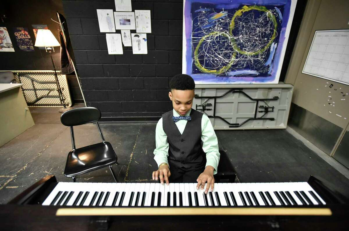Hamden, Connecticut - January 23, 2020: Brandyn Geddie, a Ridge Hill School 5th-grader, plays on a piano in the green room after competing in the second annual Hamden Education Foundation presentation of the
