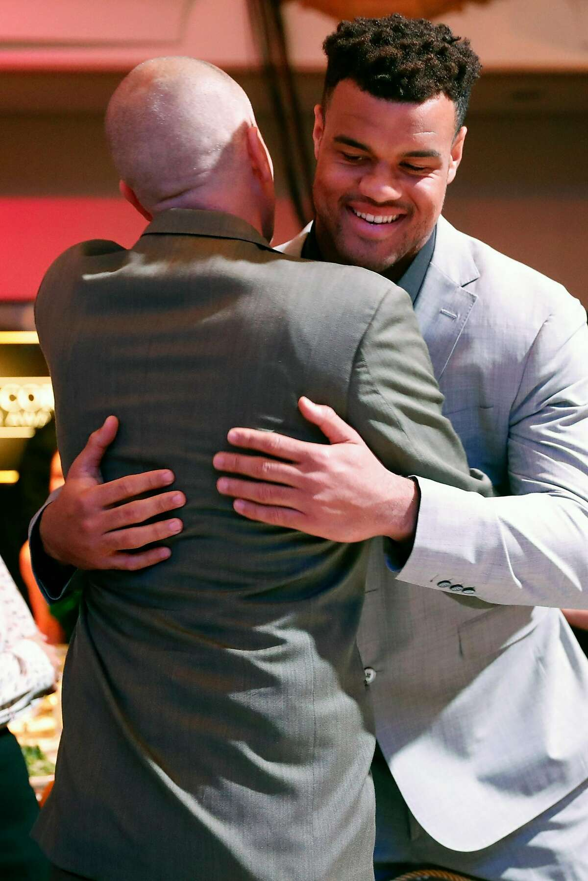 49ers' Arik Armstead greets his high school coach Joe Cattolico at Game Changers banquet at Fairmont Hotel in San Francisco, Calif., on Thursday, January 23, 2020.