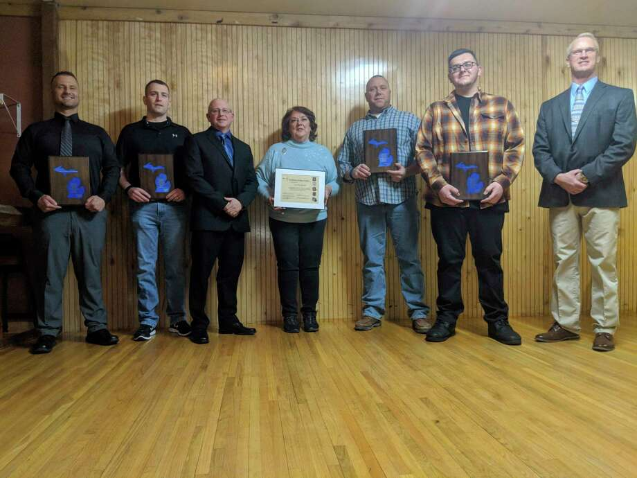 Those recognized during the 2020 Gladwin County Crime Stoppers appreciation dinner and presenters include, from left, corrections officer of the year Justin Longstreth; Gladwin Police officer Nate Day for officer of the year; Gladwin Police Chief Eric Killian; Gladwin County Crime Stoppers Secretary Kathy Wilton; Gladwin Police officer Rodney Foster for officer of the year; dispatcher of the year Josh Tweed; and Gladwin County Sheriff Mike Shea. (Photo by Tereasa Nims/For the Daily News)