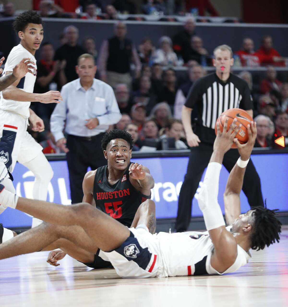 Houston Cougars center Brison Gresham (55) looks at Connecticut Huskies forward Isaiah Whaley (5) as he tried to pass the ball from the floor during the second half of an NCAA basketball game at the Fertitta in Houston, Thursday, Jan. 23, 2020.