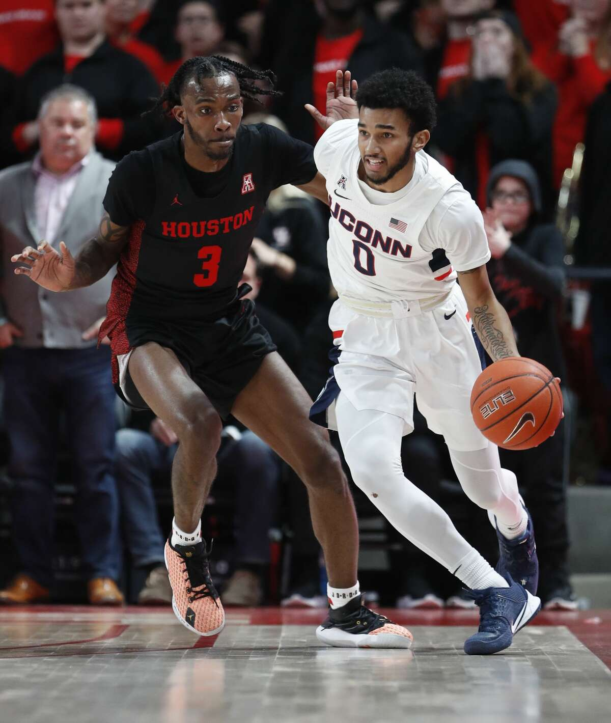 Houston Cougars guard DeJon Jarreau (3) puts the defense on against Connecticut Huskies guard Jalen Gaffney (0) during the second half of an NCAA basketball game at the Fertitta in Houston, Thursday, Jan. 23, 2020.