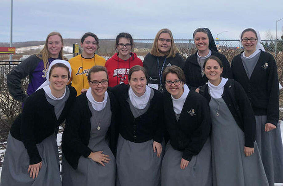 Routt students Kirby Peters (back row, from left), Emily Cosgriff, Abby Beddingfield and Grace Rawe take a photo with the Alton-based Sisters of the Martyr St. George in Washington, D.C., where they will participate in the annual March for Life.