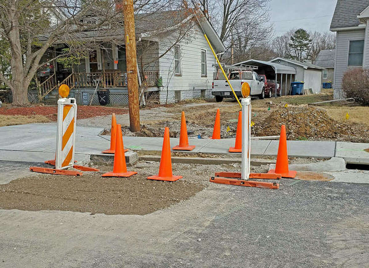 A roughly four-foot square is cut out during Phase two of the Hale Avenue reconstruction project that recently received black-top. A roughly six-foot stretch of concrete curbing is also cut out.