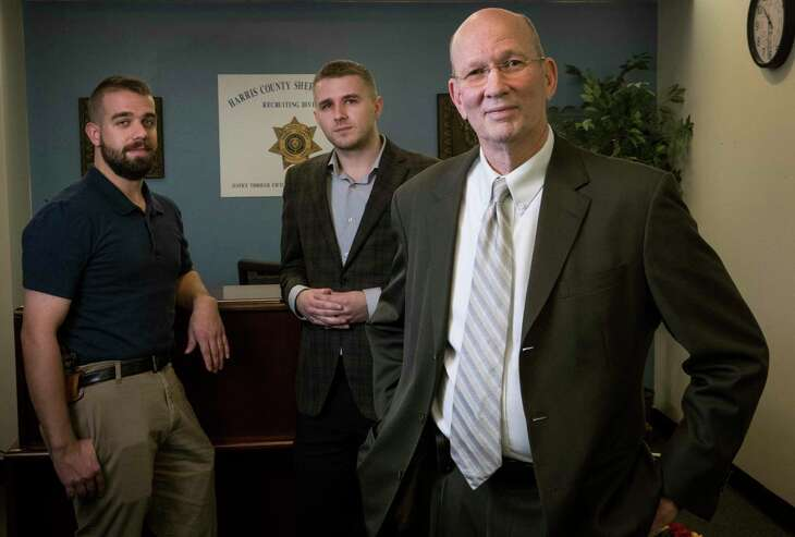 Investigator Jacob Walker, left, Anthony Bush, analyst and manager Brad Rudolph make up the new Harris County Sheriff's Office's Behavioral Threat Assessment Unit, which targets stalkers and potentially dangerous situations.