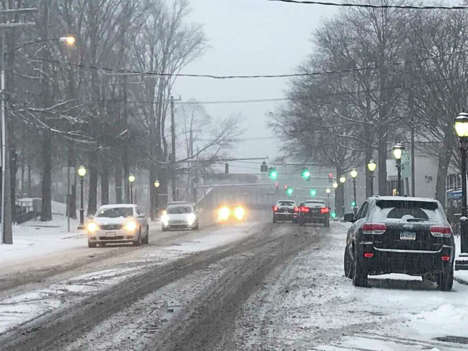 A snowy street in Darien. Darien Police are reminding residents and businesses of the policy for clearing snow off sidewalks. Photo: Diane Farrell