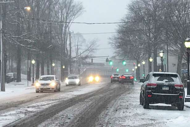 A snowy street in Darien. Darien Police are reminding residents and businesses of the policy for clearing snow off sidewalks.