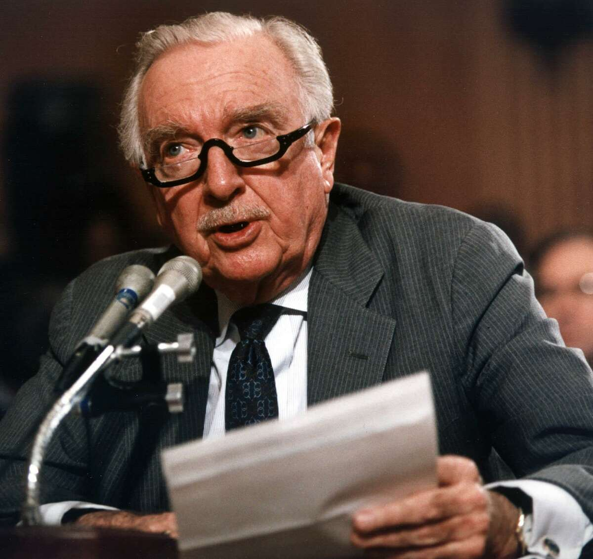 This February 20, 1991 file photograph shows former CBS anchor Walter Cronkite testifying before the US Senate Committee in Washington, DC, on Governmental Affairs concerning the Pentagon rules on media access to the Persian Gulf War.
