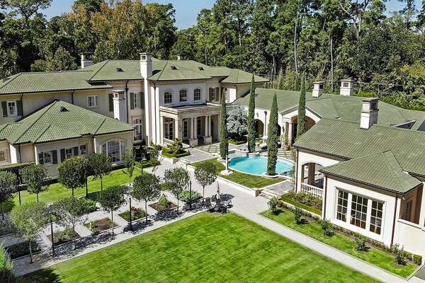 Located at 526 W Friar Tuck Lane in Sherwood Forest, the $16.5 million home offers five bedrooms, six full and three half bathrooms, 1000+ bottle wine cellar, resort-style pool, loggia, summer kitchen, putting green and herb garden.