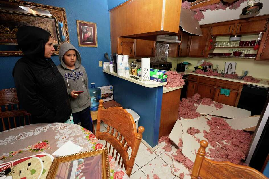 Maria Hernandez and her son, Alejandro Ambriz, 10, stand by the kitchen where the ceiling collapsed in their home in the 5400 block of Talina Way just one street east of Watson Grinding and Manufacturing, located at 4525 Gessner Rd., where an explosion occurred Friday, January 24, 2020 in Houston.