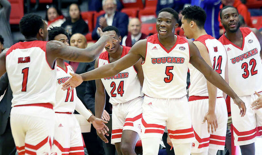 SIUE's (from left) Mike Adewunmi, Kenyon Duling, Brandon Jackson and Zeke Moore celebrate during Thursday night's Cougars victory over Southeast Missouri state University at the Vadalabene Center. Photo: SIUE Athletics