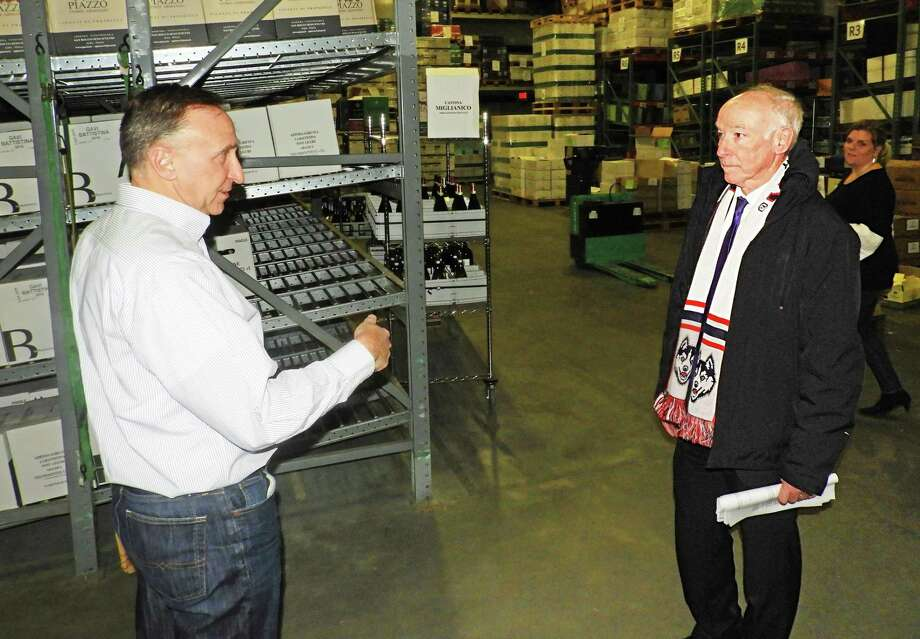 U.S. Rep. Joe Courtney, right, visited Angelini Wine in the Centerbrook section of Essex earlier this week. The company is facing financial hardship due to tariffs on wine from the European Union, according to a press release. At left is co-owner Julius Angelini. Photo: Contributed Photo