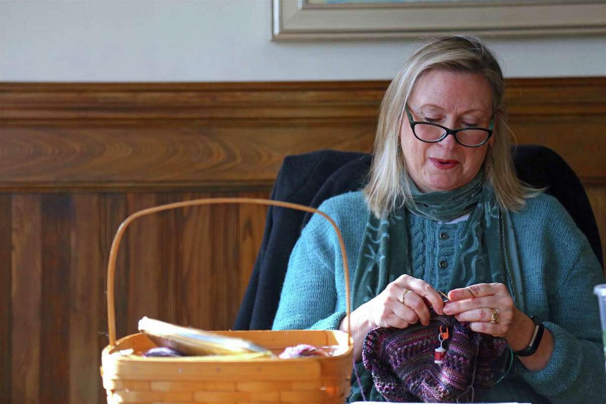 Barbara Bangser of Westport works on a project at the weekly session of the Pequot Purls at Pequot Library last week.