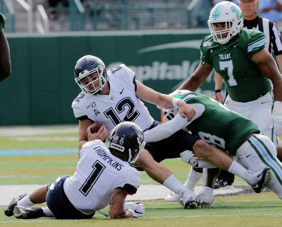 Connecticut quarterback Mike Beaudry gets sacked by Tulane linebacker Marvin Moody during an NCAA college football game Oct. 12, 2019, in New Orleans. Photo: Associated Press / The Advocate