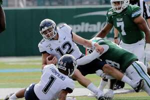 Connecticut quarterback Mike Beaudry gets sacked by Tulane linebacker Marvin Moody during an NCAA college football game Oct. 12, 2019, in New Orleans.