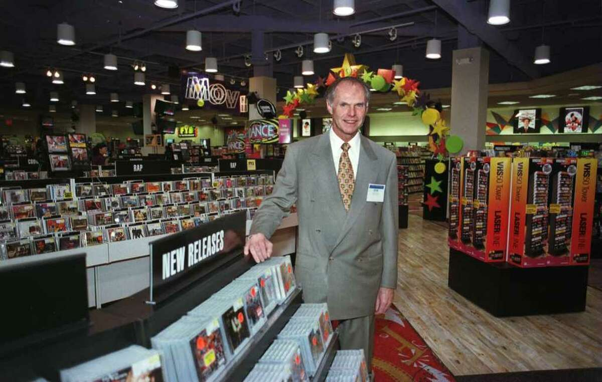 Robert Higgins, president and CEO of FYE, stands in the Colonie store in 1997 ahead of its grand opening.