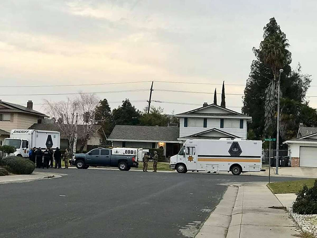 Authorities are working to clear a home where hundreds of military-style explosives were found Thursday.