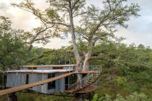 Romantic Treehouse:  Spicewood   Let your inner kid out with your loved one as you spend your vacation in this house among the leaves. This listing features a two-story deck, private bathhouse and great views. There is also a zip-lining tour option.   1 bed/Shared bath   $728 per night    GlampingHub.com