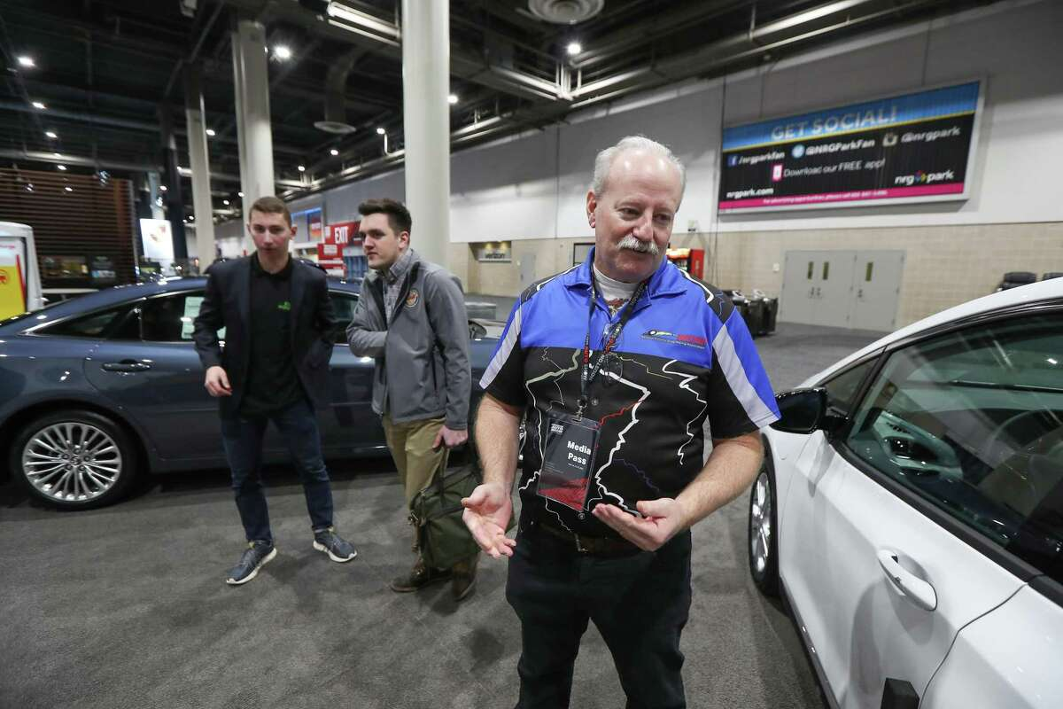 Keith Howard talks about electric vehicles at the Evolve Houston Showroom at the Houston Auto Show Wednesday, Jan. 22, 2020, in Houston.