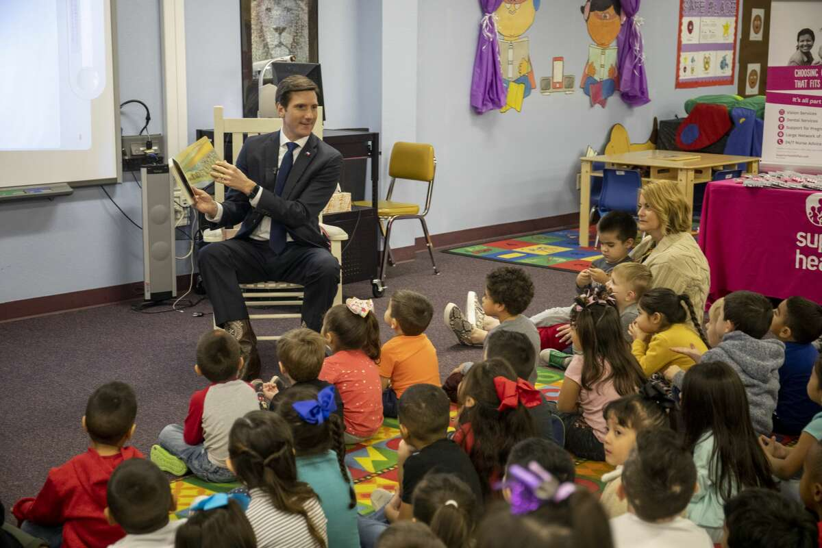"""Students celebrated National Reading Day with story time from Rep. Brooks Landgraf reading ?'The Little Engine that Could?"""" and a Nursery Rhyme Living Museum on Thursday, Jan. 23, 2020 at Carver Early Education Center. Jacy Lewis/Reporter-Telegram"""