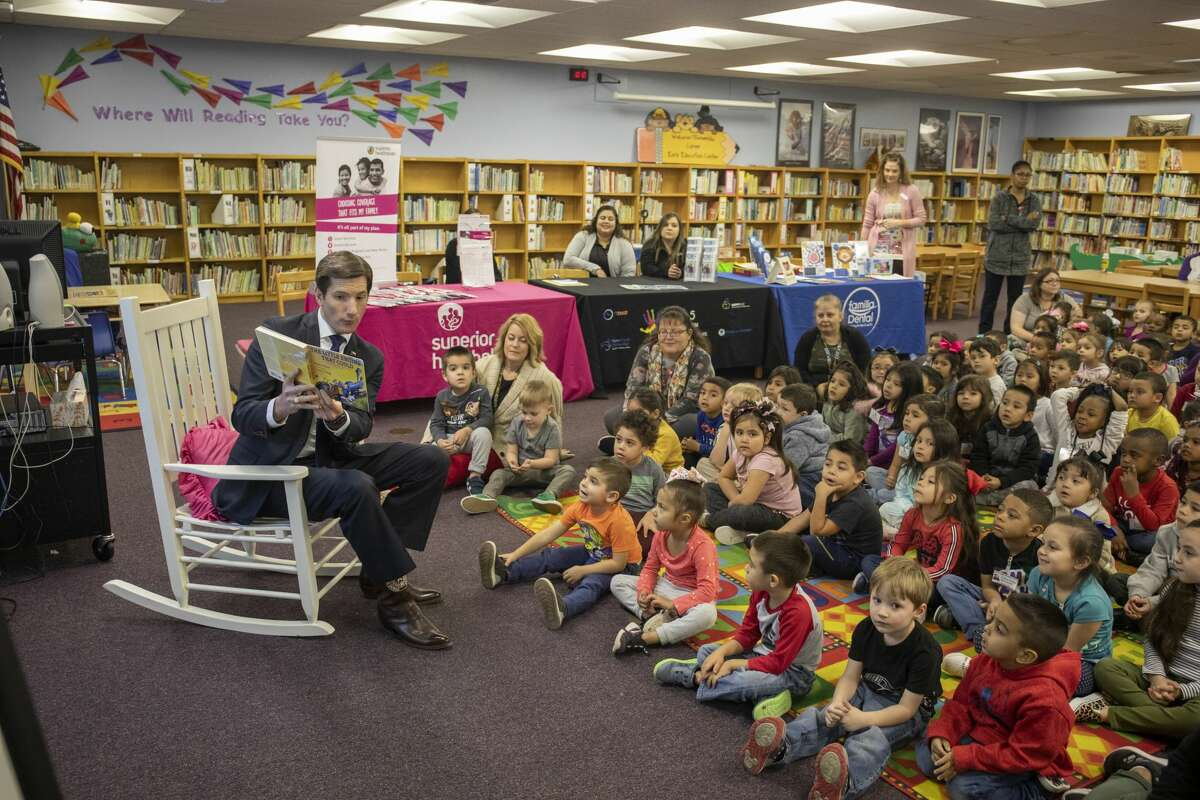 """Students celebrated National Reading Day with story time from Rep. Brooks Landgraf reading """"The Little Engine that Could"""" and a Nursery Rhyme Living Museum on Thursday, Jan. 23, 2020 at Carver Early Education Center. Jacy Lewis/Reporter-Telegram"""