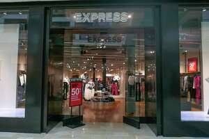 An Express clothing store is seen at the Mall of the Mellenia in Orlando, Fla. on Jan. 22, 2020. Express plans to close about 100 stores as part of a restructuring plan. (AP Photo/John Raoux)