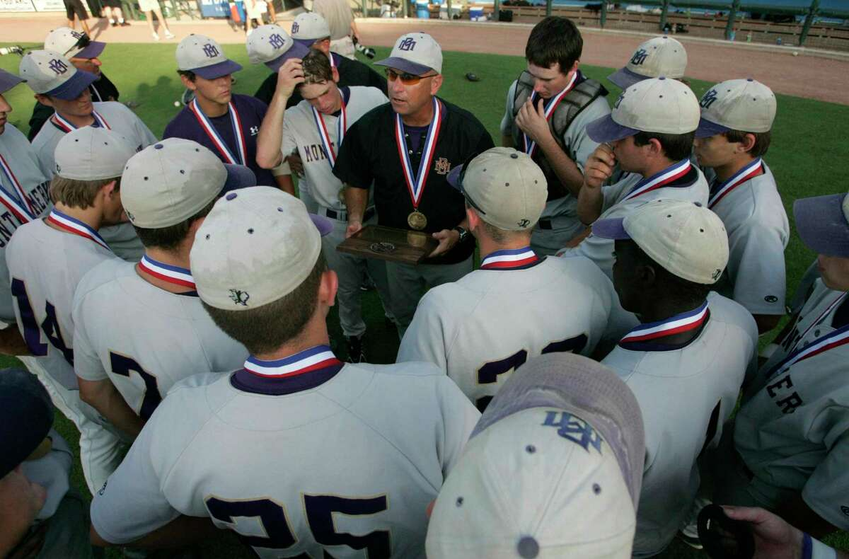 Montgomery High School Head Coach Clint Heard (center) talks with his team after losing aginst Waco Midway High School at the UIL 4A State Baseball Championship in 2005. Heard, now athletic director for Montgomery ISD, wants to turn a Montgomery High School storage building into batting cages for both the baseball and softball teams. Heard approached the school board on Jan. 21 with a request for over $50,000 to renovate the old building into a new indoor hitting facility.