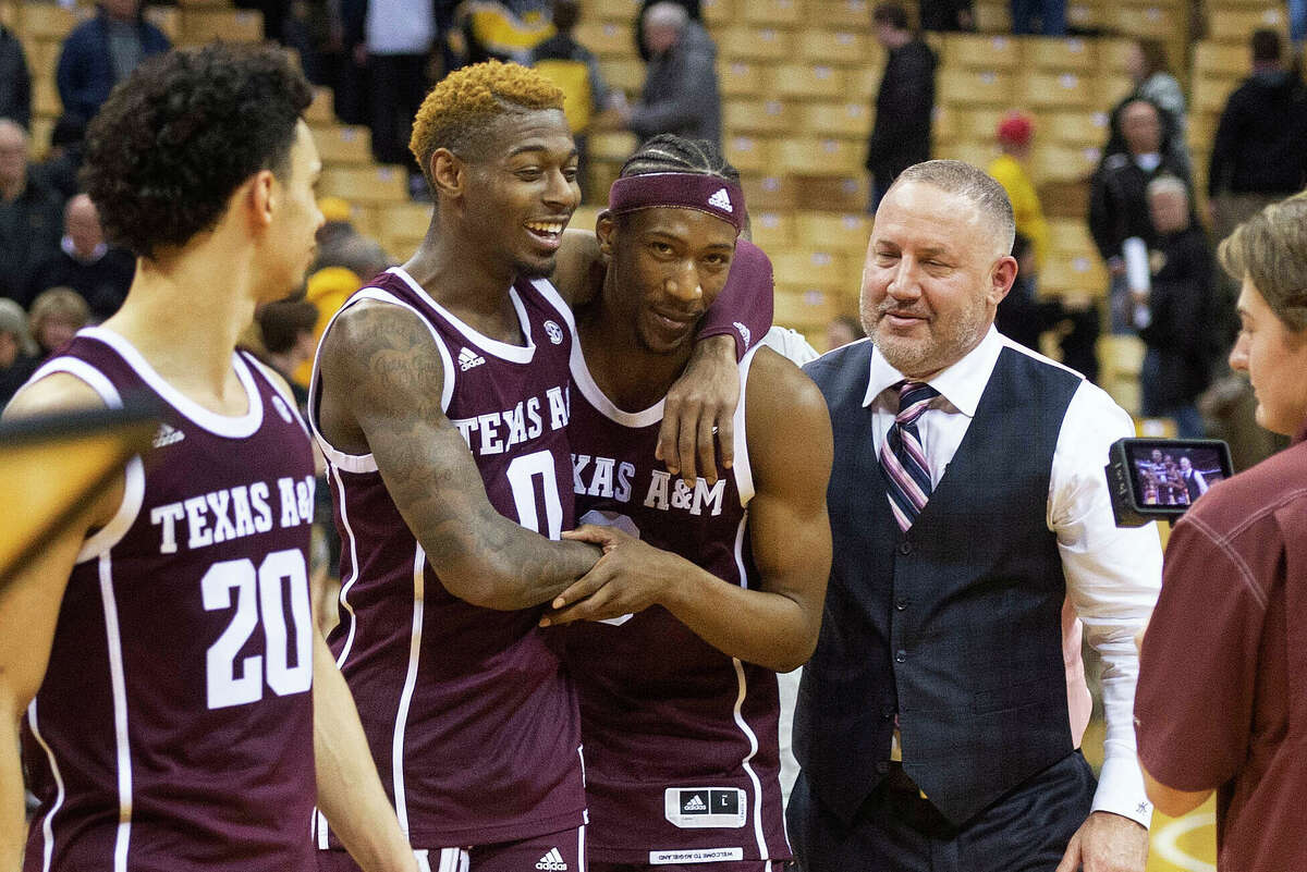 Texas A&M head coach Buzz Williams, right, celebrates with players Quenton Jackson, center, and Jay Jay Chandler, right, after they defeated Missouri 66-64 in an NCAA college basketball game Tuesday, Jan. 21, 2020, in Columbia, Mo. (AP Photo/L.G. Patterson)