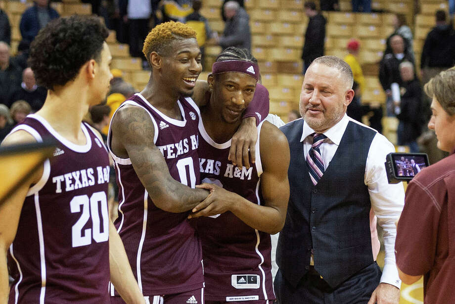 Texas A&M head coach Buzz Williams, right, celebrates with players Quenton Jackson, center, and Jay Jay Chandler, right, after they defeated Missouri 66-64 in an NCAA college basketball game Tuesday, Jan. 21, 2020, in Columbia, Mo. (AP Photo/L.G. Patterson) Photo: L.G. Patterson, Associated Press / Copyright 2020 The Associated Press. All rights reserved