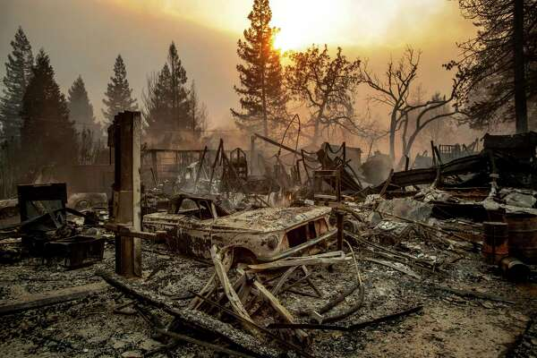 FILE - This Nov. 8, 2018, file photo shows a vintage car among debris after the Camp Fire tears through Paradise, Calif. California officials said Tuesday, Nov. 19, 2019, that crews have finished removing millions of tons of debris left by a Northern California wildfire that killed 85 people and virtually annihilated a town. The Camp Fire was the deadliest and most destructive wildfire in state history. (AP Photo/Noah Berger, File)