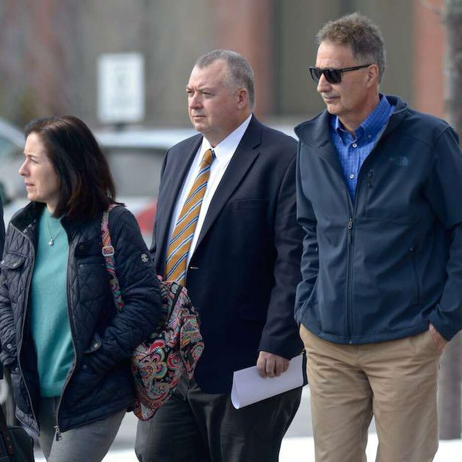 Former New Milford Information Technology director Kendrick Protzmann, center, leaves Litchfield Judicial District Courthouse at Torrington Friday morning, January 24, 2020, in Torrington, Conn. Photo: H John Voorhees III / Hearst Connecticut Media / The News-Times